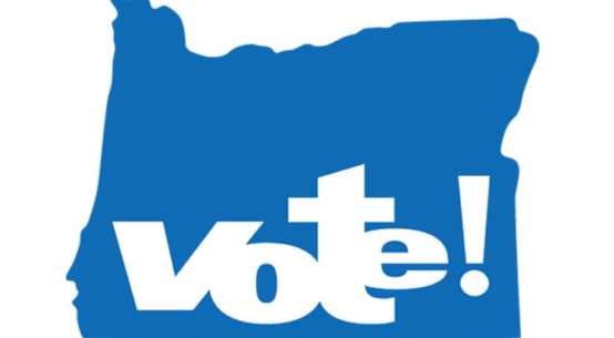 The word vote with an exclamation point is imposed over an outline of the state of Oregon