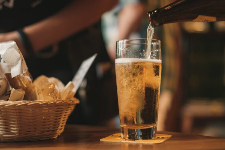 beer being pored into a glass
