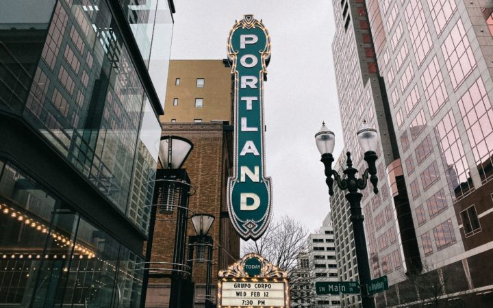The marquee sign for the Portland Center For The Performing Arts is shown on a downtown Main Street in Portland, Oregon