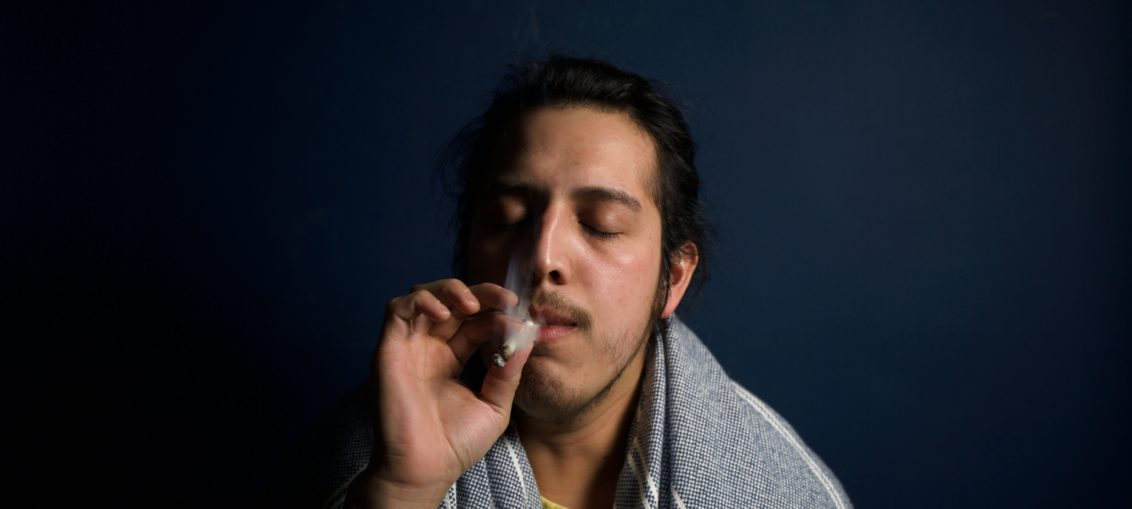 Man smokes a joint