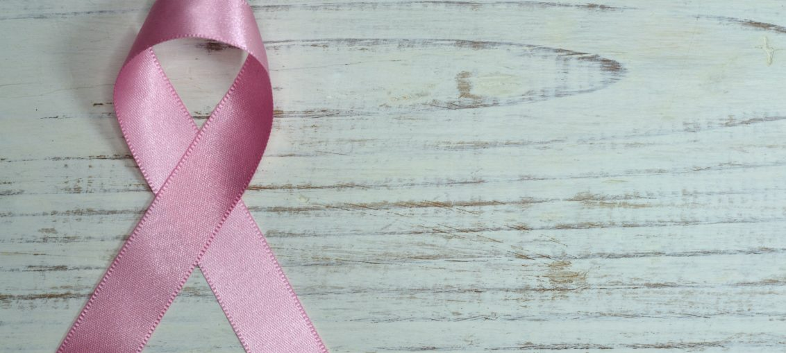 A pink ribbon representing women's cancer awreness