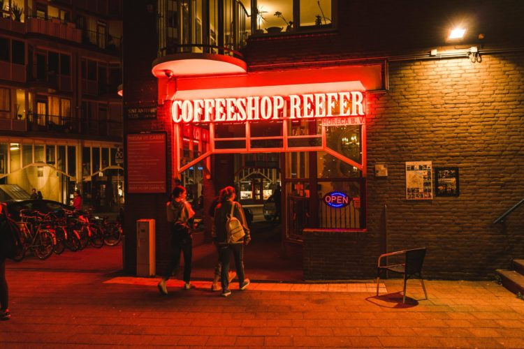 A cannabis cafe in the Netherlands with a neon sigh reading Coffeeshop Reefer