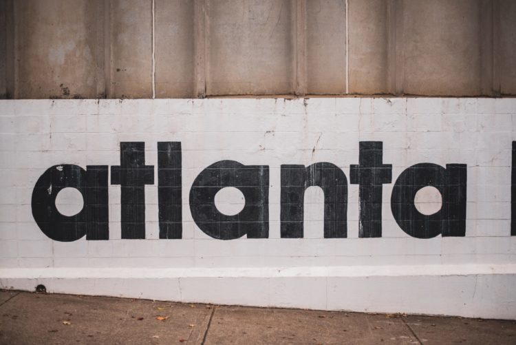 The word Atlanta is seen painted on a wall