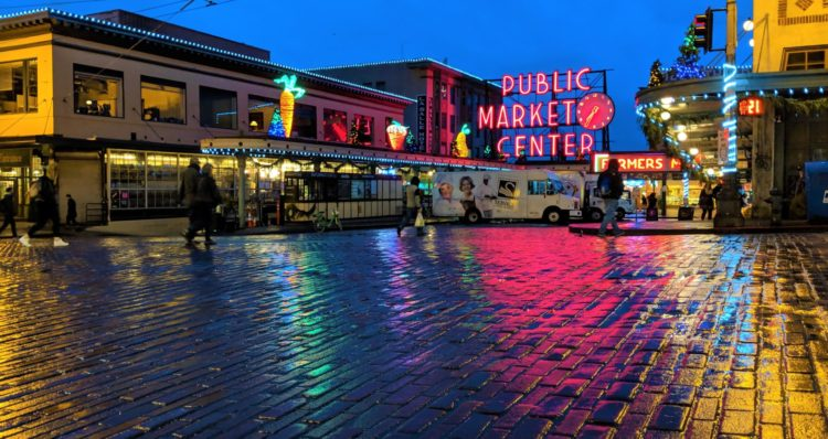 A nighttime photo of the Seattle Public Place Market sign