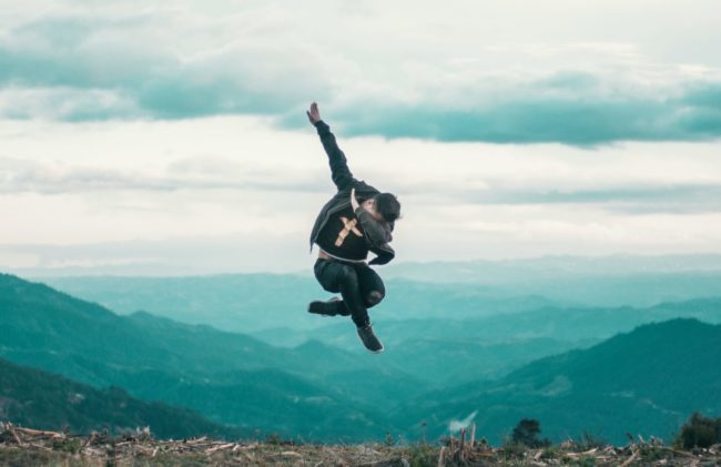 "A man jumps and does ""the Dab"" high above a city"